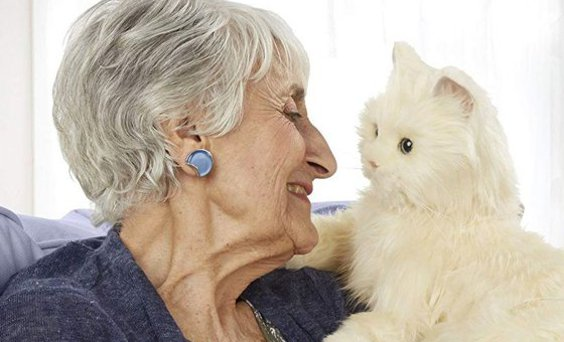 Older woman cuddling and gazing into the eyes of a white toy cat